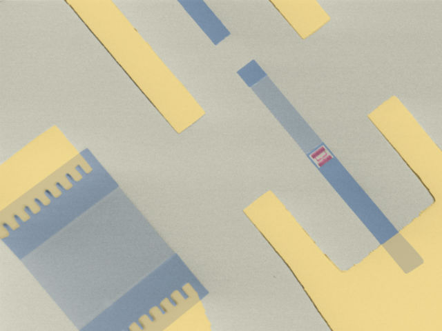 Снимок микроскопа, демонстрирующий искусственный атом, способный излучать и поглощать звук, который движется по поверхности микрочипа (фото Martin Gustafsson/Maria Ekström).